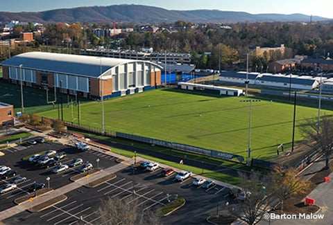 View of the University of Virginia's Athletic Complex natural turf practice fields with the Blue Ridge Mountains in the background.