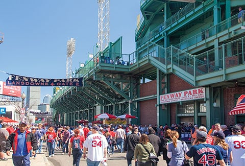 Pedestrians stroll along Lansdowne Street outside of Fenway Park in Boston.