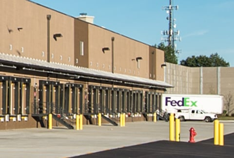 Birds fly over the truck bays at the FedEx Distribution Center in Natick, Massachusetts.