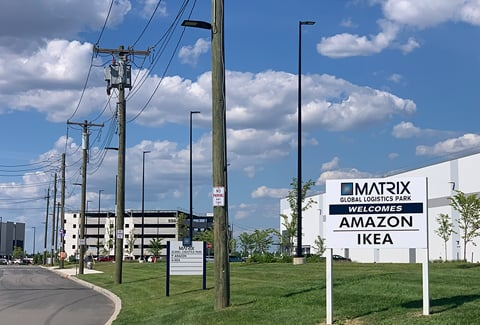 A sign welcomes Amazon and Ikea to the industrial park.
