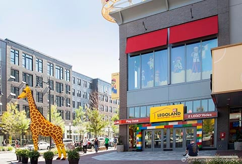 A giraffe statue welcomes visitors outside of the Lego store at Assembly Row.