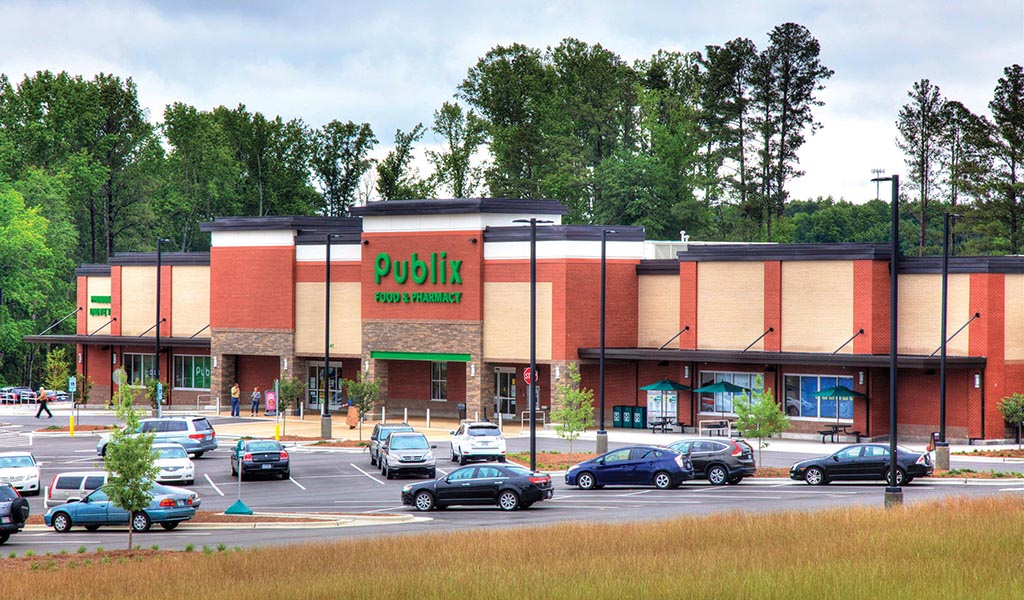 Publix grocery store storefront and parking lot in Apex, North Carolina.