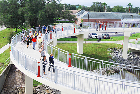 Pedestrians on the Kissimmee Trail Bridge cross on helical approach ramps.