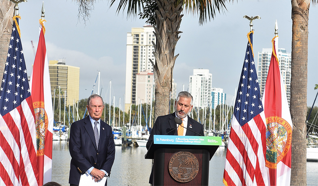 St. Petersburg Mayor Rick Kriseman accepts the American Cities Climate Challenge award from Michael Bloomberg at Albert Whitted Park in January 2019.