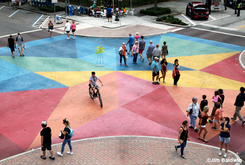 People cross an artistically painted intersection in St. Petersburg.