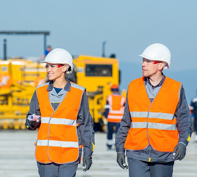two engineers at airport runway