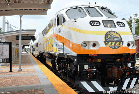 A SunRail train engine waits at a station.