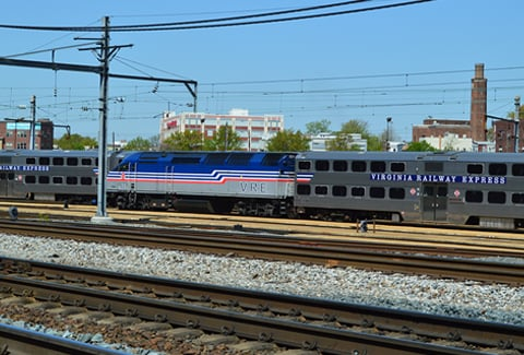 VRE engine and passenger car stationed in railyard