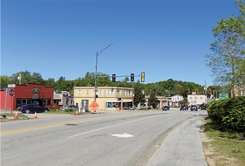 Route 202 intersection with stoplights and buildings prior to improvements.