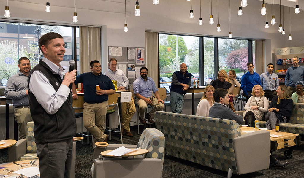 Employees at VHB's Watertown office hosting the 2019 VHB Cares live auction at the company's headquarters.