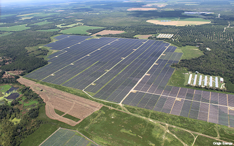 A solar farm stretches across formal rural agricultural land in Georgia, providing clean, renewable energy to thousands of area homes.