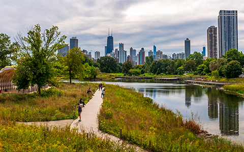 View of Jackson Park with walkways, water, and Chicago skyline in background