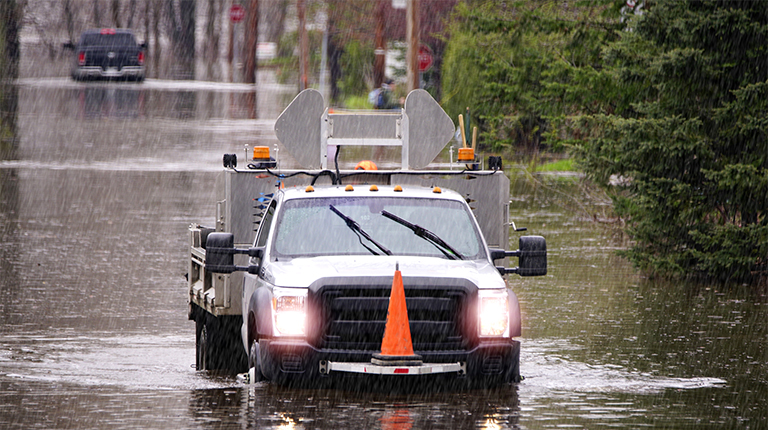 Image of a emergency truck on a flooded city street