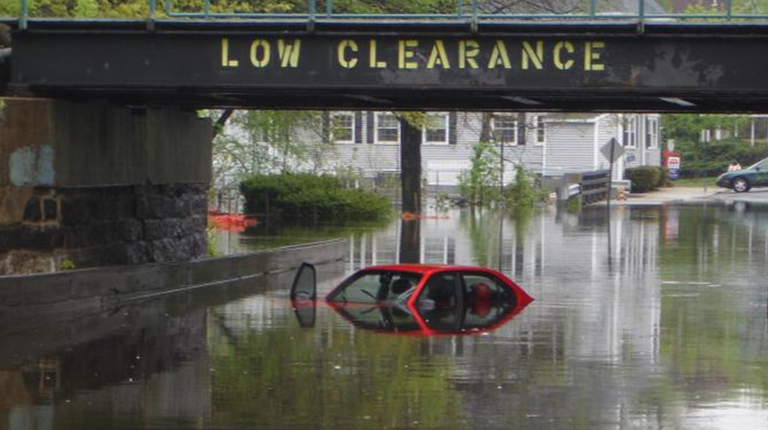 Car submerged in water caused by flooding of the Aberjona River in Winchester, Massachusetts.