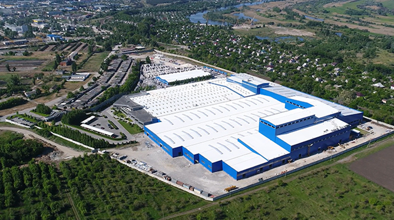 Aerial view of an industrial and manufacturing facility in an urban area